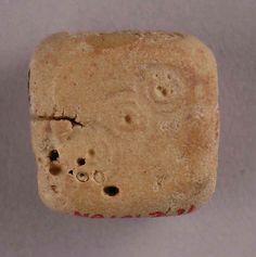 Die (MMA 48.101.211c) - d6, Bone; incised. Iran, Nishapur, 9th-10th century CE. Dimensions: 9/16 in. (1.4 cm) squared. In the collection of the Metropolitan Museum of Art.