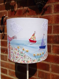 Seascape appliquéd and embroidered lampshade