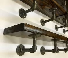 DIY black metal pipe and wood shelves with cast iron floor flange, elbow, pipe fittings Industrial Pipe Shelves, Rustic Shelves, Industrial House, Wood Shelves, Industrial Metal, Industrial Interior Design, Cafe Interior, Metal Pipe, Wood And Metal