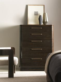 caracole modern streamline chest generously rounded corners recessed plinth base sleek faade and retroera metal hardware help this chest make the