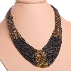 Traditional Ukrainian Folk Handmade Glass Jewelry Beads Beaded Necklace Gerdan Black/Gold. $29.05, via Etsy.