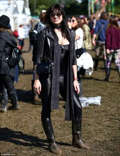 Rock chick: Daisy Lowelooked every inch the lead singer herself as she stunned in a skintight black catsuit and glittery jacket at Glastonbury festival on Friday