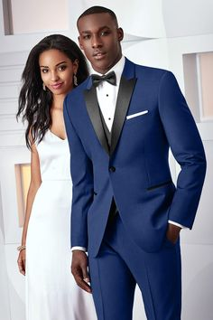 Make a statement with the Cobalt Blue Tribeca at your next formal affair. The ultra slim fit styling is tailored to fit all body types - including big and tall sizes. The Tribeca is tailored in a soft, luxurious Super 120's wool fabric. It features a black satin peak lapel, black satin double besom pockets and black satin covered buttons. Pair it with a pair of matching or black ultra slim fit pants for a trim and tapered styling. The price on this page reflects the complete package pricing…