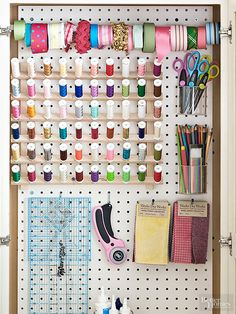 Pegboard isn't just for workbenches. A sheet was cut to fit inside a cabinet and painted with durable oil-base paint. Hooks hold tools and fabric swatches. Clear plastic cups house scissors and colored pencils. A tension rod holds ribbon in place./