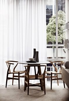 love the wishbone chairs and the carrara top table