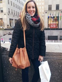 @verasweeney, shows off her J.Jill bucket bag while out and about in NYC.