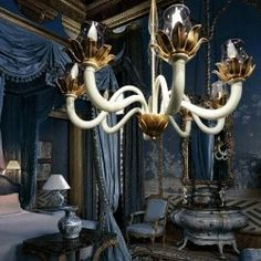 A contemporary idea of the classic eight-arms chandelier. An elegant synergy between the blown glass of Maestri Vetrai from Murano, Venice and the artistic wrought-iron inspired by the Tuscan tradition.  - See more at: http://www.rivieraluxe.it/en/_34#sthash.TG1jrUbM.dpuf