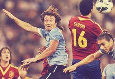 Diego Lugano, Uruguay NT, and Sergio Busquets, Spain NT.