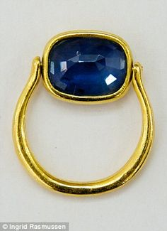 Sapphire and gold swivel ring.