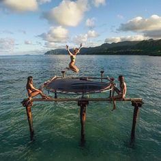 Hawaii with friends! This is a real trampoline on Oahu! PC: @threeifbythesea