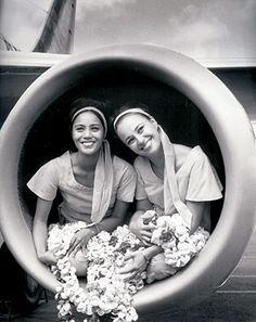PHOTOS COURTESY ALOHA AIRLINES Flight attendants poses in a jet-engine intake. An Aloha Airlines jets soars into the sky.
