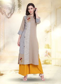 Make the heads flip when you costume up in this kind of a attractive grey cotton party wear kurti. The incredible dress creates a dramatic canvas with amazing embroidered work. Indian Designer Outfits, Indian Outfits, Designer Dresses, Indian Clothes, Outfit Essentials, Kurta Designs, Long Cotton Kurti, Designer Kurtis Online, Kurti Styles