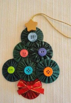 I love to make these yoyo Christmas tree ornaments when I watch television. Each one has green fabric yoyos, an assortment of buttons for trim, a Quilted Christmas Ornaments, Fabric Christmas Trees, Fabric Ornaments, Christmas Sewing, Handmade Ornaments, Handmade Christmas, Christmas Tree Decorations, Christmas Fun, Christmas Balls