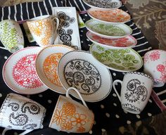 Some fantastic examples of plain dishes embellished with paint pens (Pebeo Porcelaine 150 Paint Markers) by Jane LaFazio