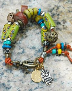 Kumasi Charm Bracelet Get your tribal on with this exotic artisan charm bracelet! I just designed this awesome bracelet to go with my Kumasi Necklace. What a wo
