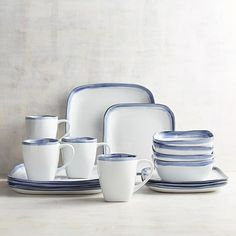Pier 1 Imports Reactive Blue Rim Square 16-Piece Dinnerware Set (2.315 ARS) ❤ liked on Polyvore featuring home, kitchen & dining, dinnerware, handmade stoneware dinnerware sets, stoneware dinnerware sets, blue square dinnerware, blue square dinnerware sets and square stoneware dinnerware