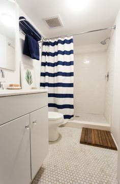 The downstairs bathroom was recently renovated as well. Matt did all the tile work in the shower and the on the floor. Floors— marble tile from Home Depot. Shower curtain— Amazon