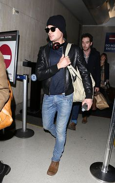Shop Zac Efron's look for $169:  http://lookastic.com/men/looks/beanie-and-crew-neck-t-shirt-and-bomber-jacket-and-jeans-and-boots/1498  — Black Beanie  — Navy Crew-neck T-shirt  — Black Leather Bomber Jacket  — Blue Jeans  — Brown Suede Boots