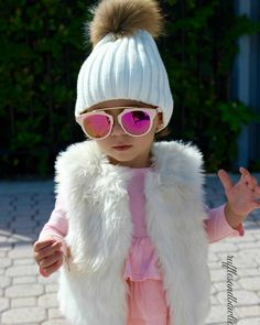 Miss Alexis is #rocking our top 3 must haves for winter! 1) Cute Beanies 2) Faux Fur Vests 3) Pink Accessories  What are your winter must haves? Let us know below!  faux fur beanies & vests still available in shop while quantities last!