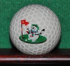 Golfing Frosty the Snowman logo golf ball. Christmas themed golf ball. Light impact mark on the logo face (pictured). The ball pictured is the ball for sale.