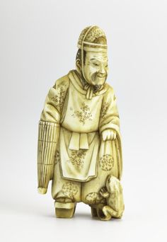 Netsuke of carved ivory, Ono no Tofu standing and wearing geta and carrying an umbrella with a frog at left foot: Japan, by Tomotsugu