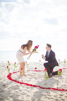 He proposed on the beach in a heart of roses, using the same ring box his father used to propose!