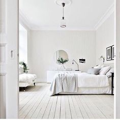 Best Minimalist Bedrooms We Want to Live In. Love the relaxed feeling of the white and bone colors.  | StyleCaster