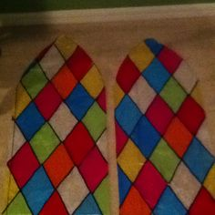 Faux Stained glass.  Vinyl shower curtain, mod podge, tissue paper, and sharpie Marker.