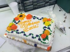 Fall flowers buttercream sheet cake with orange, mustard yellow, and plum drop flowers, mums, roses, and a sun flower.
