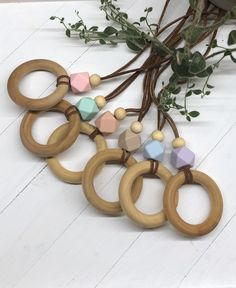 Babies teething necklaces for mom, perfect for nursing/breastfeeding too! Flower Girl Headpiece, Flower Girl Crown, Teething Problems, Teething Necklace For Mom, Wooden Baby Toys, Personalized Baby Blankets, Gender Neutral Baby, Baby Swaddle, Trendy Accessories