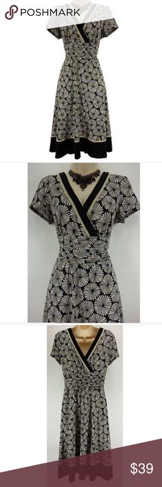 """Size 12 Medium SURPLICE PRINT DRESS Day/Evening Size: Tag says """"12"""", but this piece may run small... Please double-check posted measurements below ~ Slip on/ off Surplice neckline in front AND in back Stretchy, comfortable fabric Flattering ruched waist  Black, neutral, & white print Measurements: Bust (armpit to armpit): 37"""" relaxed - stretches to 46"""" Waist: 28"""" relaxed - stretches to 42"""" Hips: 48"""" relaxed Length: 41.5"""" (top of shoulder to bottom hem)  Condition: LIKE NEW! Fabric Content…"""
