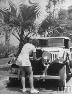 Hollywood Street Scene: Washing the car.  Location: Hollywood, CA, US  Date taken: 1936  Photographer: Alfred Eisenstaedt
