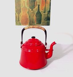 A personal favorite from my Etsy shop https://www.etsy.com/listing/481476845/bright-red-enameltea-kettle-with-wicker
