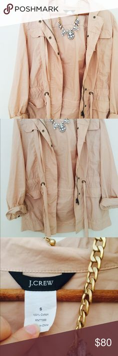 J. Crew Pink Spring Jacket This spring jacket is so cute! It is very lightweight and has a cargo look. It has a drawstring to cinch the waist. There are plenty of pockets and a hood! In very good condition! J. Crew Jackets & Coats