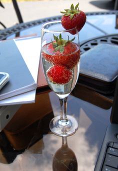 """Strawberry champagne punch: champagne, ginger ale, frozen strawberries. Or just strawberries."""