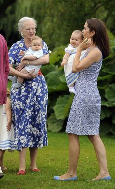 Queen Margrethe II, Crown Princess Mary and the twins Vincent Frederik Minik Alexander and Josephine Sophia Ivalo Mathilda pose during a photocall at Grasten Castle on August 1, 2011 in Grasten, Denmark.