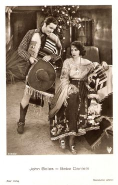 https://flic.kr/p/NrBaPX | Bebe Daniels and John Boles in Rio Rita (1929) | German postcard by Ross Verlag, no. 51592, 1930-1931. Photo: Radio Pictures (RKO). Publicity still for Rio Rita (Luther Reed, 1929).  Bebe Daniels (1901-1971) was an American actress, singer, dancer, writer and producer. She began her career in Hollywood during the silent film era as a child actress and later a the love interest of Harold Lloyd in dozens of short comedies. Cecil B. de Mille made her a silent star…