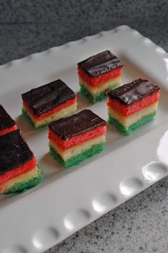 My Son's Tri-Color Italian Cookies | Amaretto-soaked layers of sponge cake made with almond paste, filled with apricot preserves and topped with semi-sweet chocolate!
