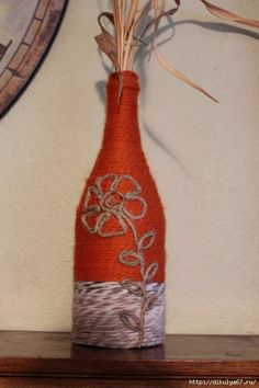 This re-purposed wine bottle is wrapped with various colored yarns and twine. Each bottle has a detailed sailboat made from twine. Wine Bottle Art, Painted Wine Bottles, Diy Bottle, Wine Bottle Crafts, Mason Jar Crafts, Twine Bottles, Bottles And Jars, Liquor Bottles, Wine Craft