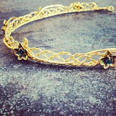 A gold circlet headdress inspired by the one Eowyn wore at Aragorn's coronation in the Lord of the Rings, Return of the King. This Lady of Rohan crown is handmade by the circlet wizard at...@ artfire