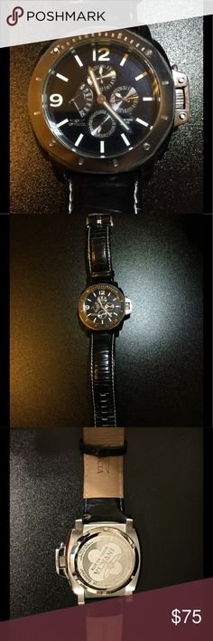 Invicta Chronograph Invicta Chronograph with black face and leather band. In great condition. Invicta Accessories Watches