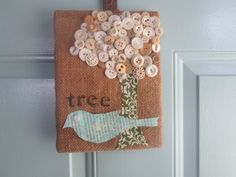 I just finished this item recently.  Tree with vintage buttons and a bird from old book page.