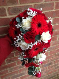 Teardrop bouquet of Freedom Red Roses, Avalanche White Roses, Red Gerberas and Gypsophila