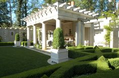 Boxwood parterre & courtyard garden by Howard Design Studio.