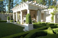 Pergola... Boxwood parterre & courtyard garden by Howard Design Studio.