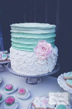 ruffled white and mint wedding cake http://www.weddingchicks.com/2014/02/17/romantic-dessert-table/