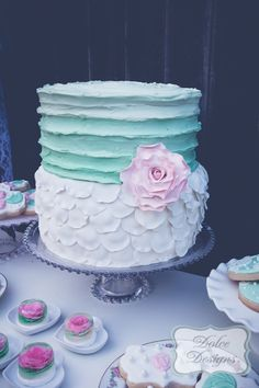 ruffled white and mint wedding cake http://www.weddingchicks.com/2014/02/17/romantic-dessert-table/