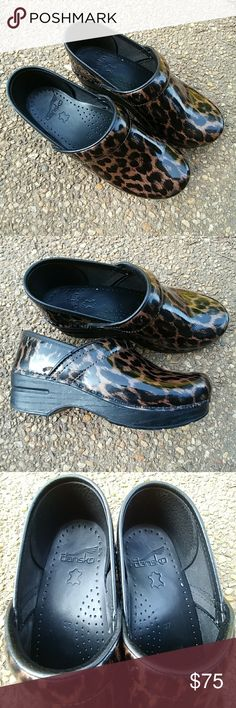 Dansko leopard print clogs Used in excellent condition small scuff in front pictured above. Still have lots of life left. Dansko Shoes Mules & Clogs
