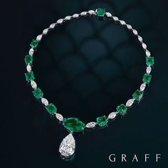 Emerald and Diamond Delight A curated collection of unique emeralds and exquisite white diamonds provide the perfect frame for a rare 19.23 carat D Internally Flawless pear shape diamond drop. #graff
