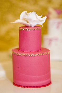 Gold piping and a white rose pop against this hot pink mini